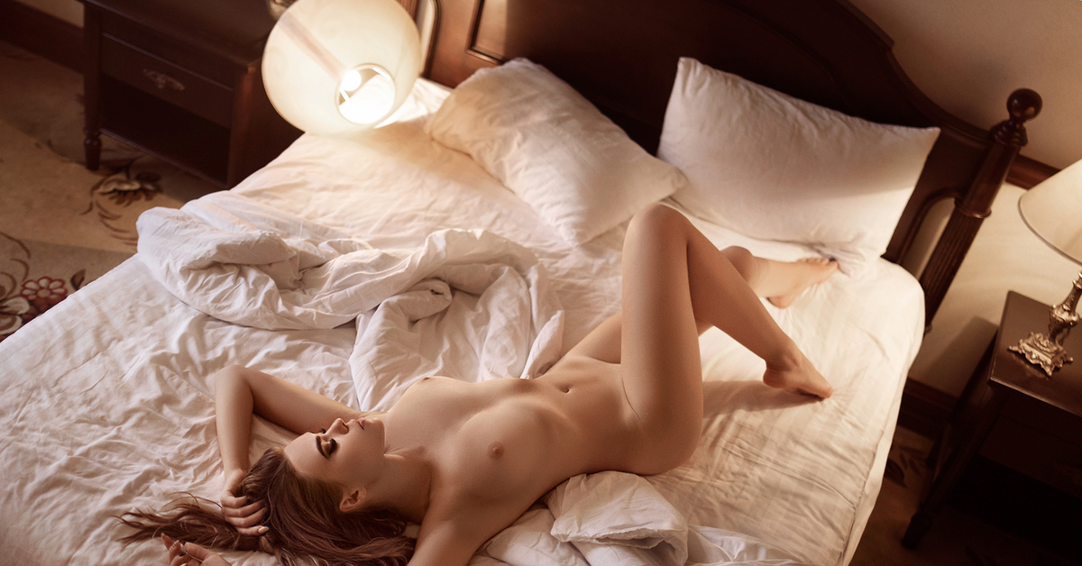 In the bed naked
