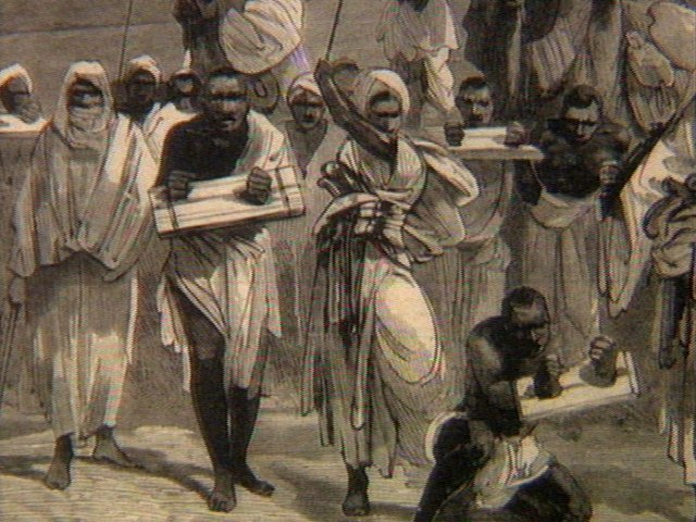 Заковывание рабов в кандалы